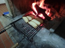 Grilling the bread on the fire.