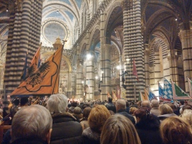 Inside the Duomo of Siena for mass to celebrate Sant'Ansano and the contrade.