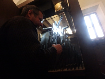 Riccardo, the organ restorer, tuning the organ in the Duomo in Colle di Val d'Elsa