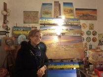 Another artisan we met is Loretta, an artist. She hand-paints everything in her shop; on canvas, wood, terracotta, even stones.