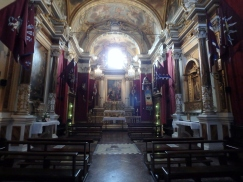 The church of the Torre contrada. Torre's colors are crimson with blue and white bands or stripes of various designs.