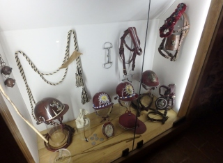 A display of hats and bridles of Torre riders, or fantini.