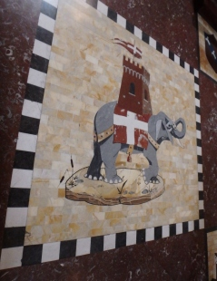 The symbol of the Torre contrada, an elephant, on the floor of the church.
