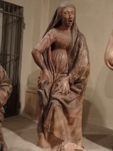 Maria of Salome'. Look at her hands. She's almost tearing at the skin on her legs.
