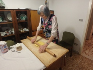 And then we bring out the rolling pin. Maria rolls out the dough with such ease and speed.