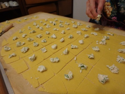 Each square gets a dollop of ricotta filling.