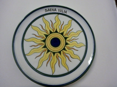 A ceramic plate on the wall in the school