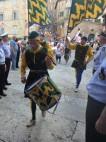 Members of the Nobile Contrada del Bruco (caterpillar contrada) as they enter the church of Santa Maria in Provenzano.