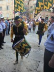 Members of the Nobile Contrada del Bruco (caterpillar contrada) as they enter the church of Santa Maria in Provenzano.