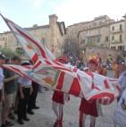Giraffe contrada representatives in the procession enter the church of Santa Maria in Provenzano.