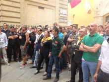 Aquila contrada members, and their jockey in the dark green, heading into the Piazza.