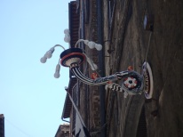 A light fixture in the Lupa contrada, which won the Palio after going 27 years without a victory