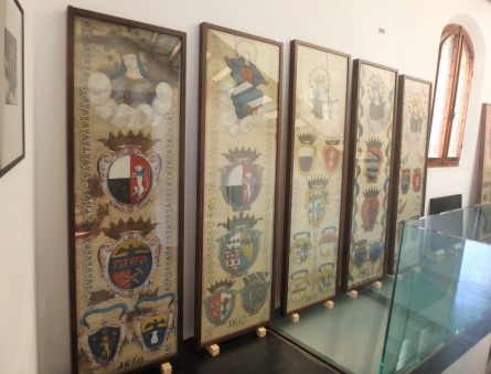 Palio victory banners from the 1800s in the Unicorn contrada museum.