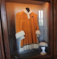 Traditional vestments for the corteo storico. Note also the hat and the wig to the right.