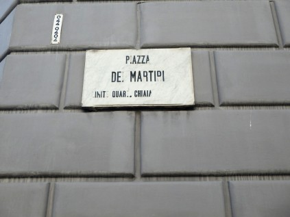 Piazza dei Martiri, a locale in the Ferrante books where the Solara brothers open a shoe store.