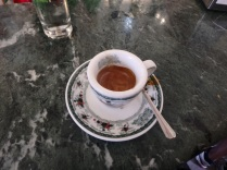 I admire the shot of espresso as I wait for the cup to cool off enough so I can drink it. Coffee is a religion in Naples. The cups are pulled from boiling water with tongs just before the espresso goes in. One does not serve coffee in cups at room temperature in Naples.