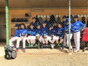 The YMCA Grosseto Little League team in the dugout.