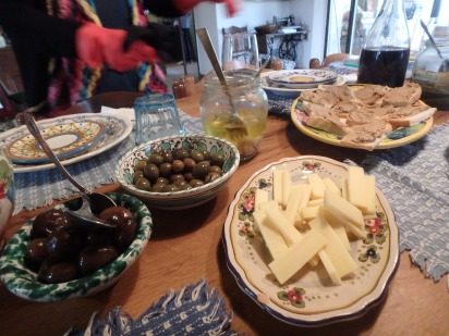 Olives, cheese, crostini wine, sweet onions.