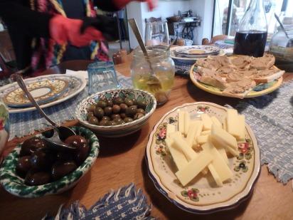 Olives, cheese, crostini wine, sweet onions.