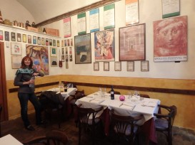 My friend Paola inside the osteria. The wall was covered with posters, some decades old, of the famous Spoleto music festival.