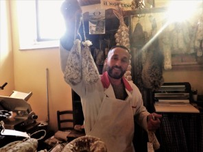 The salumeria owner, who was from Norcia. He told us about the recovery efforts, or lack thereof, in the town. He's holding up coglioni del mulo. It's a type of salami that gets its name from its shape: mule's balls. (!)