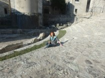 My friend Paola sitting in the Roman ampitheater