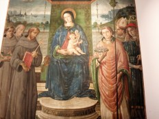 """Madonna and child with Saints"" is in the art museum connected to the former church of San Francesco. I thought it was interesting because it depicted another saint, St Fortunatus, holding a model of Montefalco."