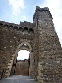 Outside the fortress at Montalcino. The town holds concerts inside the grounds, which also houses an enoteca.