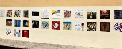 Brunello producers ask artists to design labels for their vintages. The samples are displayed on this wall in the town.