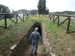 Dario walking into one of the tombs in Castellina.