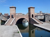 The pedestrian bridge over the canal.