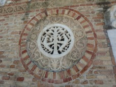 The carved window on the Church of Santa Maria.