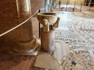 Detail of the floor of the church of Santa Maria and a water basin.