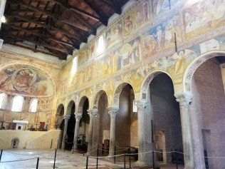 Inside the church of Santa Maria. The frescoes tell stories from the Bible.