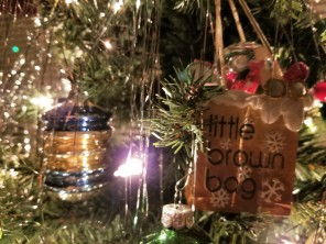 A Bloomingdale's ornament next to an ornament my mom bought at Woolworth's when she was little.