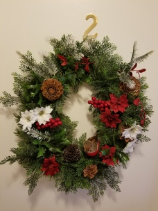 My wreath, re-fashioned from a wreath my mom had made. I don't have her skill for this. I just winged it!