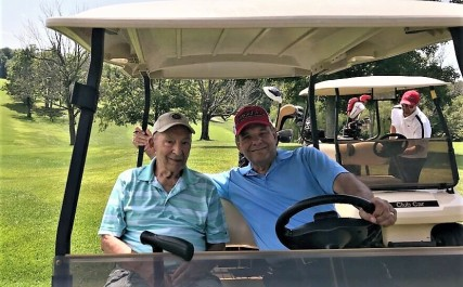 L to R: Uncle Charlie and Cousin Roger at the golf outing before the picnic.