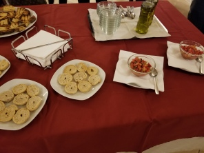 Friselle (crunchy bread) and tomatoes at the ready for the olive oil tasting. (Tomatoes in Puglia are some of the best I've ever eaten)