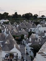 View of the shopping area and the Trulli from the photo spot. (Photo by Melanie F)